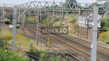 Electric Virgin Passenger Train Passing By Near Crewe