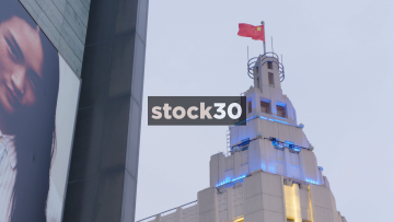 Wide Shot Of Building Flying Chinese Flag In Shanghai, China