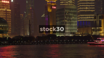 Neon Illuminated Boat Passing By On Huangpu River In Shanghai, China