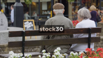 Old Couple Sitting On Bench In Harrogate, Close Up, UK