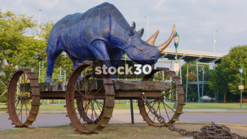 Blue Rhino Sculpture In Coolidge Park, Chattanooga, Tennessee. Wide And Close Up, USA