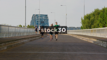 Slow Motion Shot Of People Jogging And Walking On Walnut Street Bridge In Chattanooga, Tennessee, USA