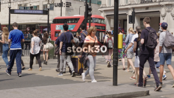 Slow Motion Shot Of Pedestrians crossing at Oxford Circus In London, UK