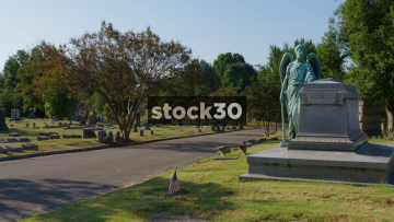 Wide Shot Of Grave With Angel In Elmwood Cemetery, Memphis, Tennessee, USA