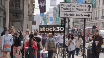 Slow Motion Shot Of Pedestrians On Regent Street In London, UK