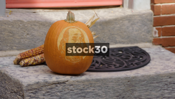 Halloween Pumpkin Carved With Benjamin Franklin's Face Outside House In Elfreth's Alley, Philadelphia, Pennsylvania, USA