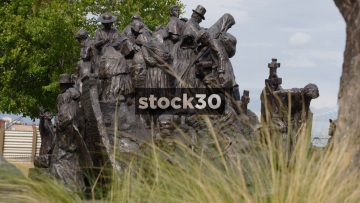 The Irish Memorial At Penn's Landing In Philadelphia, Pennsylvania, Shot From Behind Grass, USA