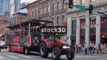 Party Tractor And Party Bus Passing By In Nashville, Tennessee, USA