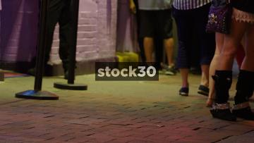 Pedestrian Feet Walking By On Sidewalk In Nashville, Tennessee, USA