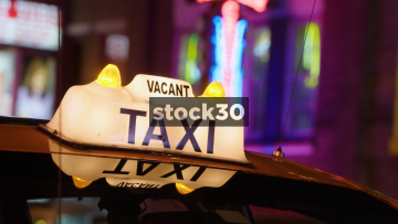Taxi Cabs And Neon Lights In Nashville, Tennessee, USA
