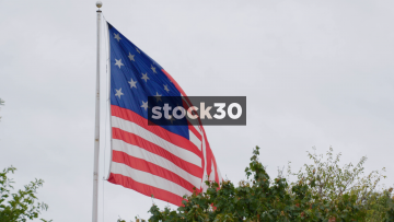 American Flag Blowing In Federal Hill Park, Baltimore, Maryland, USA