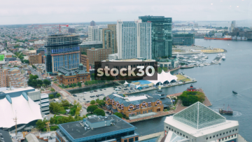 Wide Aerial Shot Of Buildings And Inner Harbor In Baltimore, Maryland, USA