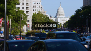 Wide Shot Of The Capitol Building In Washington DC With Traffic Passing, USA