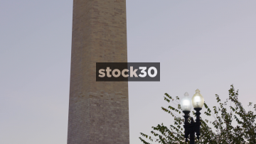 Slow Motion Close Up Of Washington Monument With Plane Passing In Background, USA