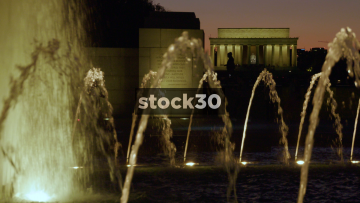 Night Shot Of World War II Memorial Fountain And Lincoln Memorial In Washington DC