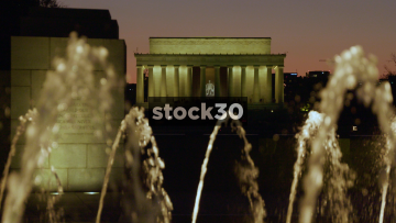 Slow Motion Night Shot Of World War II Memorial Fountain And Lincoln Memorial In Washington DC, USA