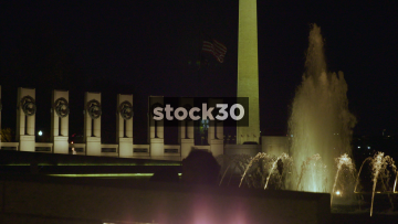 Night Shot Of World War II Memorial, Fountain And Washington Monument In Washington DC, USA