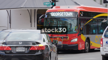 Bus Passing By In Georgetown, Washington DC, USA