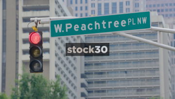 Street Sign And Traffic Light At W.Peachtree PL NW In Atlanta, Georgia, USA