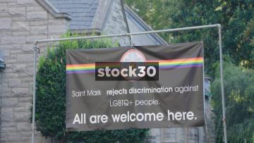 LGBTQ Sign And Rainbow Flag On Saint Mark Church In Atlanta, Georgia, USA