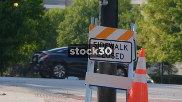 Sidewalk Closed Sign At Pedestrian Crossing In Atlanta, Georgia, USA