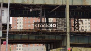 Train Passing By On Railway Bridge In Coney Island, Brooklyn, New York, USA