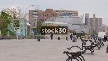 Pedestrians And Cyclists On Riegelmann Boardwalk In Coney Island, Brooklyn, New York, USA