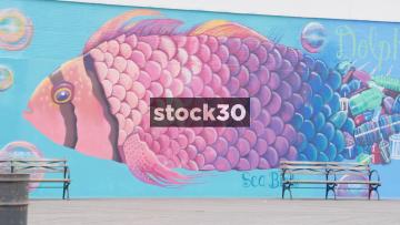People Walking Past Giant Fish Artwork In Coney Island, Brooklyn, New York, USA