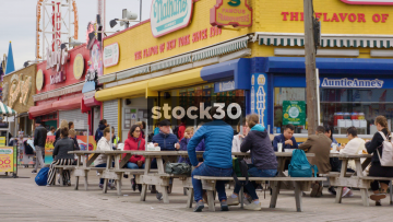 People Eating At Picnic Tables At Nathans Hot Dogs In Coney Island, Brooklyn, New York, USA