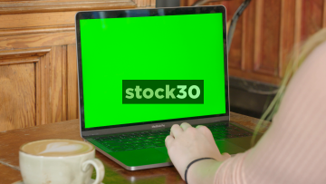 Girl In Coffee Shop Using Apple MacBook Pro Laptop, Green Screen
