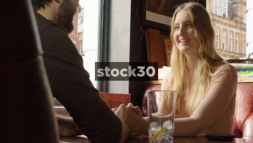 Young Happy Couple Holding Hands And Chatting In Restaurant, Woman