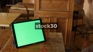 Man Watching Content On Apple iPad Pro, Shot Over Shoulder, Green Screen