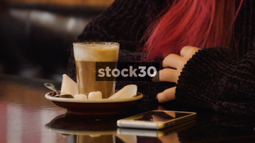 Two Young Women Chatting In Coffee Shop, Close Ups