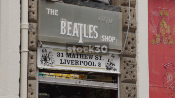 The Beatles Shop Followed By Mathew Street Sign, Liverpool, UK