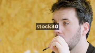Slow Motion Shot Of Man Concentrating While Studying