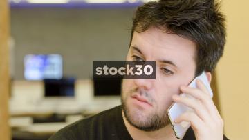 Man In Office Talking On Smart Phone