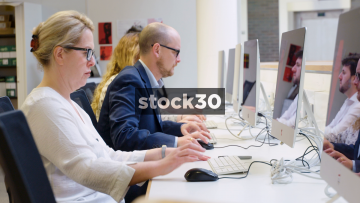 4 People Using Computers In Computer Lab - Wide Shot And Close Up