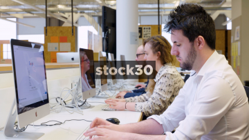 4 People Using Computers In Computer Lab - Wide Shot And Close Ups