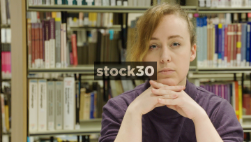 Close Up Slow Motion Shot Of Woman In Library And Contemplating, Thinking