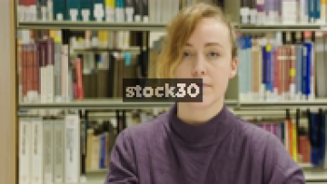 Close Up Shot Of Woman In Library Pulling Silly Faces