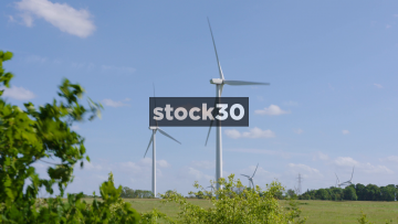 Several Wind Turbines In Countryside Field, UK