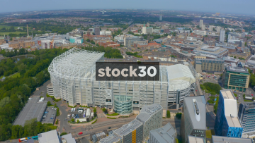Drone Shot Over St James' Park Football Stadium In Newcastle Upon Tyne, With Tilt Down To Pitch, UK