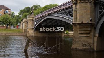 Small Boat Passing Under Skeldergate Bridge On The River Ouse In York, UK