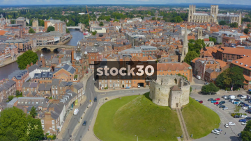 High Rotating Drone Shot Showing Clifford's Tower With York City Centre In Background, UK