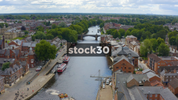 Drone Shot Over The River Ouse In York, Approaching Ouse Bridge, UK