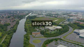 Drone Shot Over Trafford With Manchester City Centre In Distance, UK