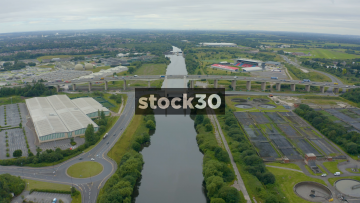 Drone Shot Approaching M60 Motorway Bridge And Salford City Rugby Stadium In Barton, Manchester, UK