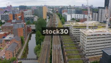 Drone Shot Tracking Metrolink Tram Over Bridge In Manchester, UK