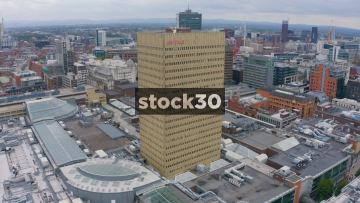Drone Shot Flying Backwards Away From Manchester Arndale Tower, UK