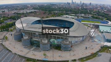 Drone Shot Orbiting Clockwise Around Manchester City's Etihad Stadium, UK